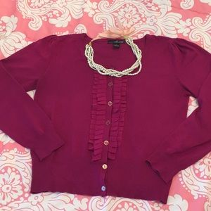 Magenta cardigan with ruffle front trim